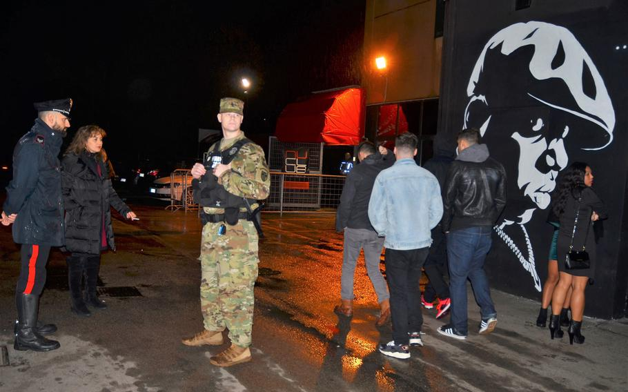 Italian Carabinieri and military police conduct a random visit at a Vicenza night spot in November. The patrols, started in response to incidents downtown, are scheduled to last for several months.