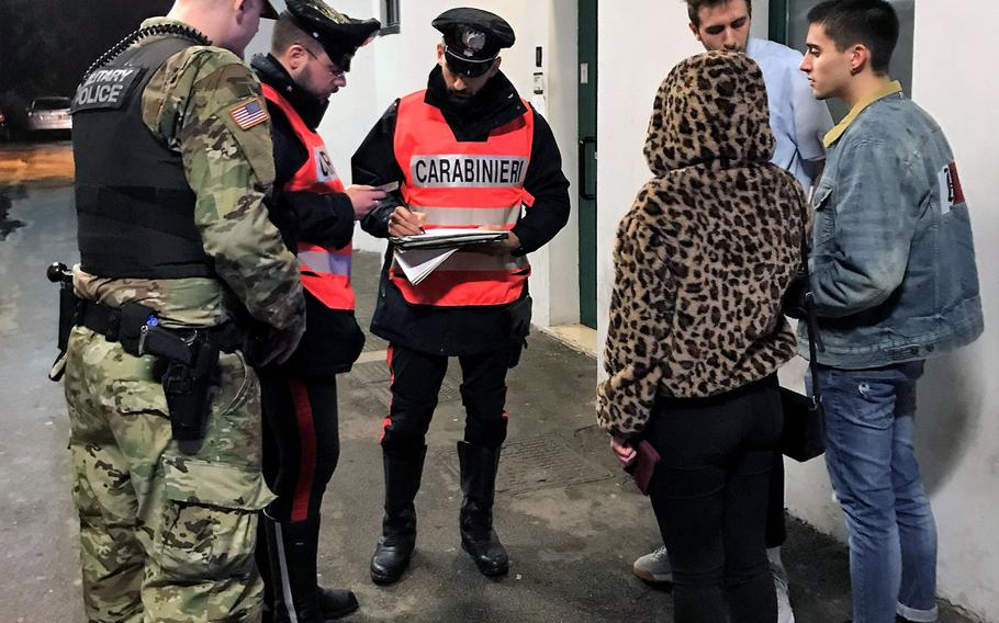 Italian Carabinieri and military police conduct random ID checks at the entrance of a nightclub in Vicenza during a joint patrol on Nov. 24, 2018.