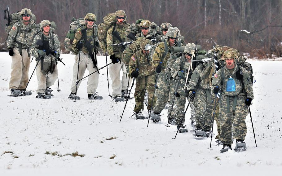 Students in the Cold-Weather Operations Course complete a ruck march in snowshoes during course training Dec. 13, 2018, at Fort McCoy, Wis.