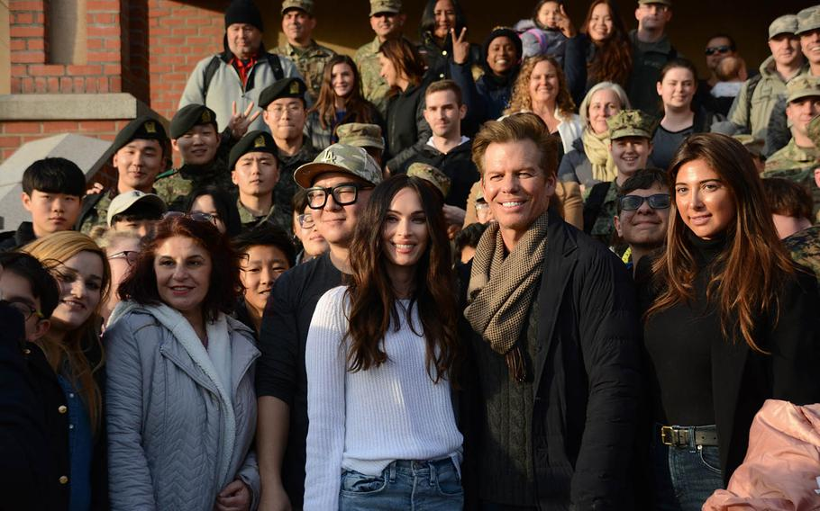 """""""Transformers"""" star Megan Fox poses for a photo with soldiers and other fans outside the theater at Yongsan Garrison in Seoul, South Korea, Wednesday, Jan. 9, 2019."""