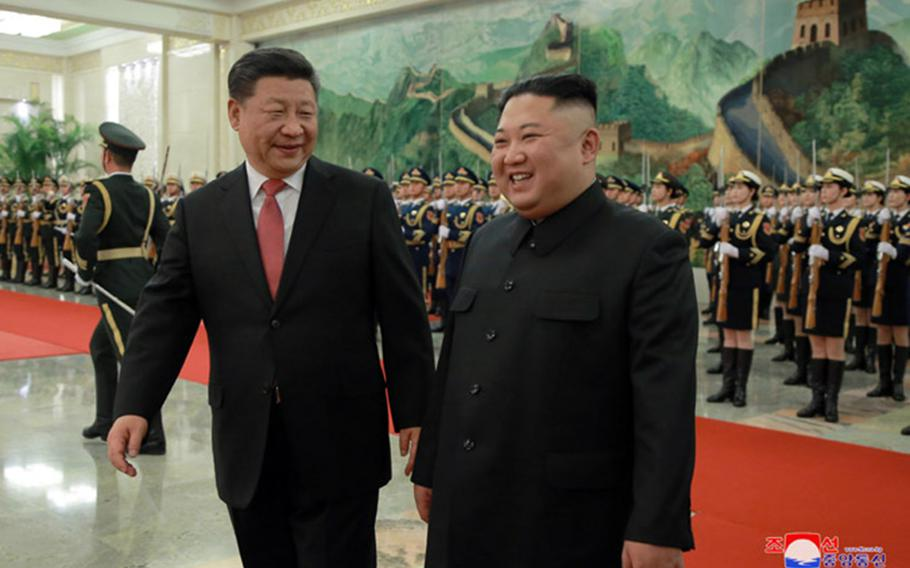 North Korean leader Kim Jong Un, right, meets with Chinese President Xi Jinping in Beijing, Tuesday, Jan. 8, 2019.