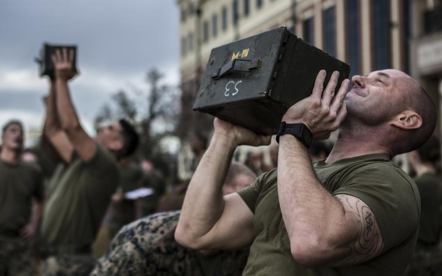 Marines with Marine Forces Reserve perform ammunition can lifts during the combat fitness test at Marine Corps Support Facility New Orleans, Dec. 14, 2018.