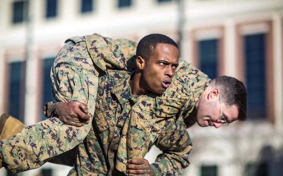 A Marine with Marine Forces Reserve conducts a fireman carry during the maneuver under fire portion of the combat fitness test at Marine Corps Support Facility New Orleans, Dec. 21, 2018.