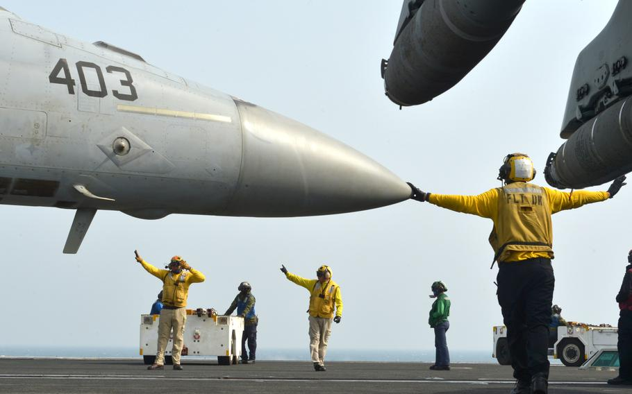 Flight deck personnel launch and recover aircraft aboard the USS John C. Stennis on Jan. 9, 2019.