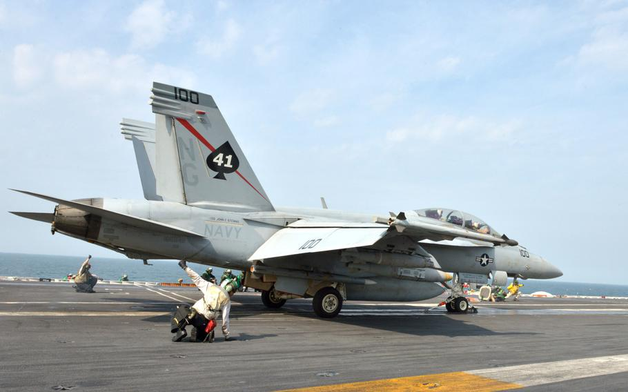 Flight deck personnel launch and recover aircraft aboard the USS John C. Stennis on Jan. 8, 2019.