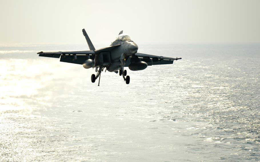 An FA-18 Hornet prepares to land on the flight deck of the USS John C. Stennis on Jan. 8, 2019.