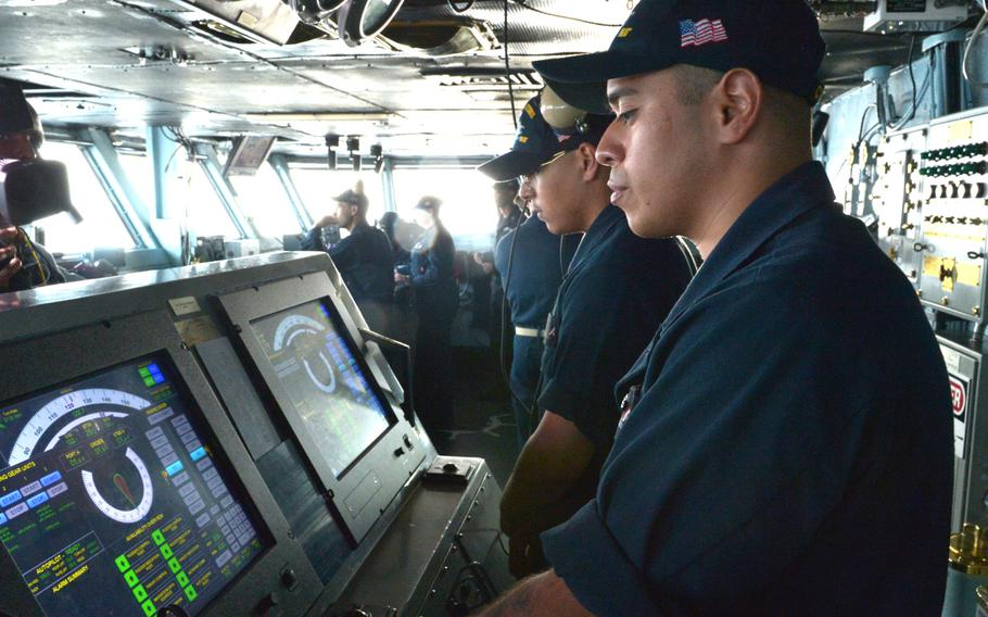 Seaman Jose Antiveros controls the helm of the USS John C. Stennis on Jan. 8, 2019.