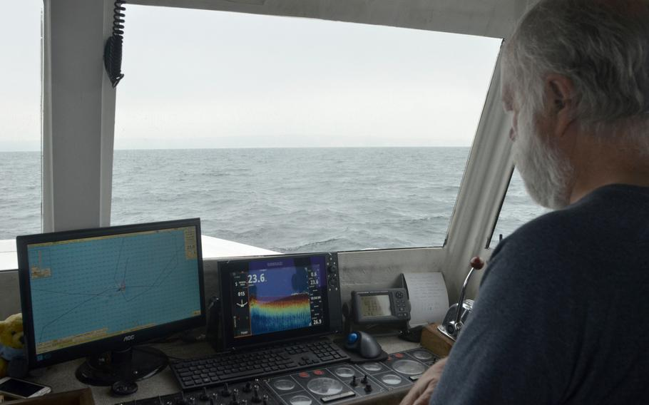 Deeper Dorset founder Grahame Knott guides his boat the RW Two to underwater wreckage of a Republic P-47D Thunderbolt in Weymouth Bay, England, on May 24, 2018. His team has taken more than 1,100 photogrammetry images over several years to map the roughly 80-feet-deep crash site with debris scattered across 5800 square feet of seabed.
