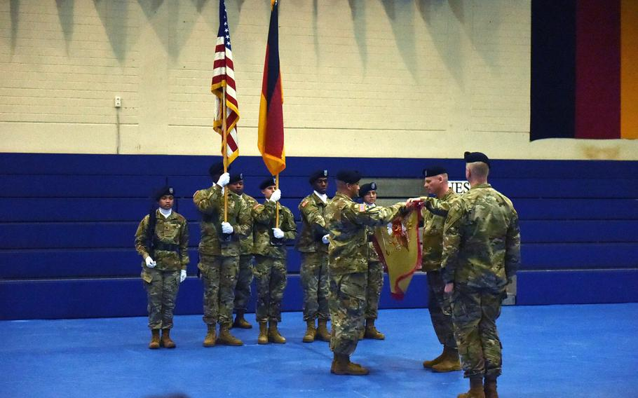 The leaders of the 589th Brigade Support Battalion unfurl the newly activated brigade's colors, during a ceremony at Grafenwoehr, Germany, Jan. 11, 2019.