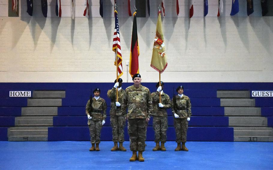 Lt. Col. Ronald Velduizen, the commander of the newly activated 589th Brigade Support Battalion, stands in front of the unit colors, after their activation ceremony at Grafenwoehr, Germany, Jan. 11, 2019.
