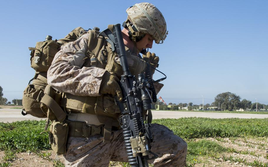 A U.S. Marine with Special Purpose Marine Air-Ground Task Force-Crisis Response-Africa adjusts his gear during a full-mission profile rehearsal in Tifnit, Morocco, Dec. 1, 2018.