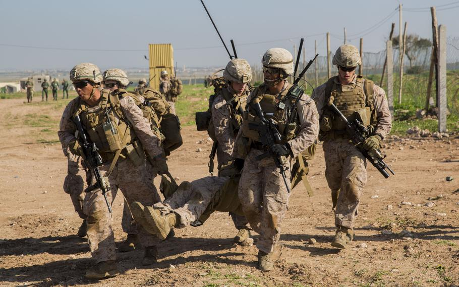 U.S. Marines and sailors with Special Purpose Marine Air-Ground Task Force-Crisis Response-Africa carry a simulated casualty during a full-mission profile rehearsal in Tifnit, Morocco, Dec. 1, 2018.