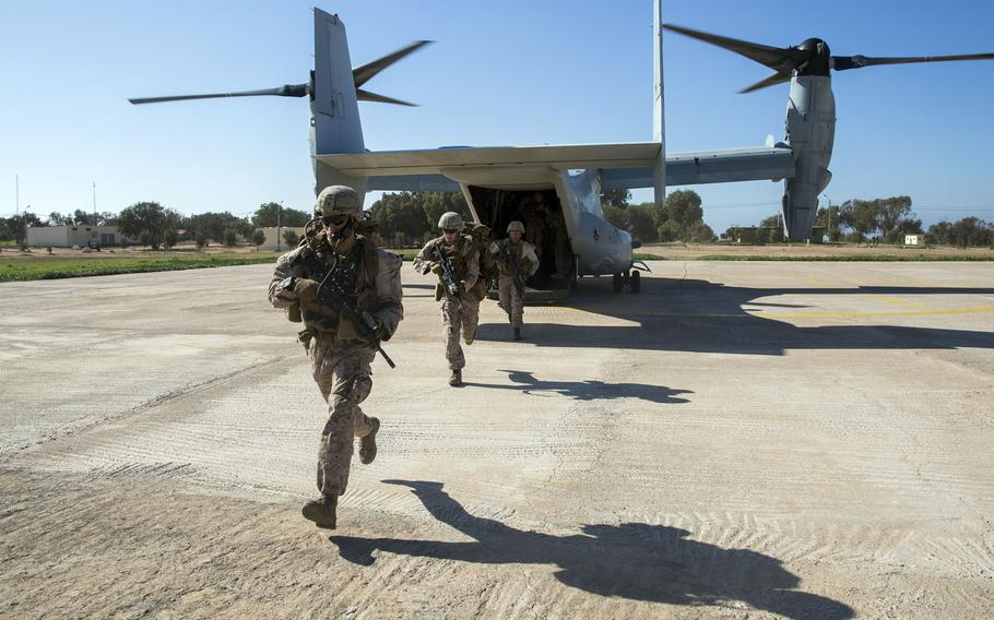 U.S. Marines with Special Purpose Marine Air-Ground Task Force-Crisis Response-Africa exit a MV-22 Osprey during a full-mission profile rehearsal in Tifnit, Morocco, Dec. 1, 2018. The rotational force deployed to conduct crisis response and theater security operations in Europe and Africa.