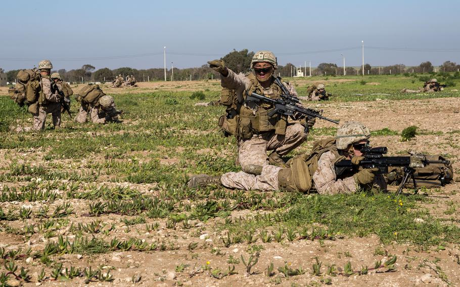 A U.S. Marine with Special Purpose Marine Air-Ground Task Force-Crisis Response-Africa gives orders during a full-mission profile rehearsal in Tifnit, Morocco, Dec. 1, 2018.