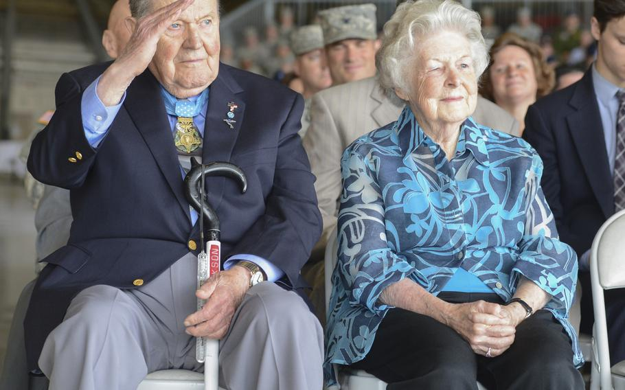Medal of Honor recipient, retired Col. Joe M. Jackson, joined by his wife Rose, returns a salute to Col. Wyn Elder, outgoing 62nd Airlift Wing commander, during a ceremony on July 17, 2013, at Joint Base Lewis-McChord, Wash. Jackson earned the Medal of Honor in 1968 for his heroic aerial evacuation of a team of pinned-down combat controllers at an overrun airfield in South Vietnam. Jackson died over the weekend at the age of 95.