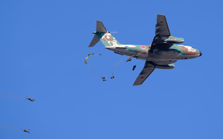 Paratroopers jump from a Kawasaki C-2 heavy transport aircraft during a drill at Narashino Training Area in Chiba prefecture, Japan, Sunday, Jan. 13, 2019.