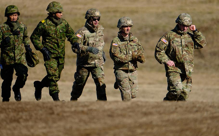 Members of the U.S. Army and Japan Ground Self-Defense Force participate in a drill at Narashino Training Area in Chiba prefecture in Japan, Jan. 13, 2019.