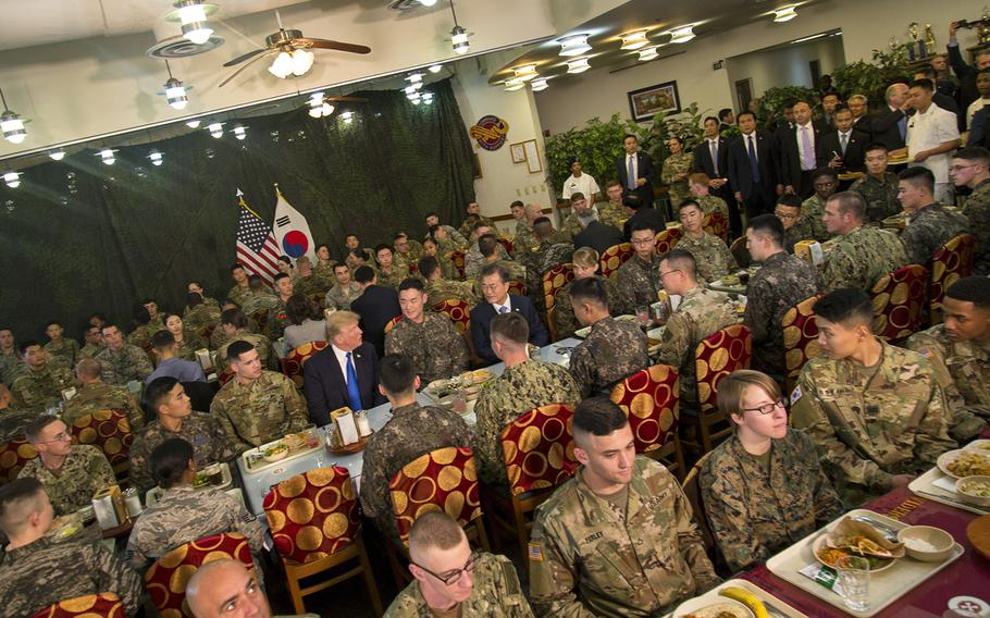 President Donald Trump speaks with South Korean President Moon Jae-in and troops from both nations over lunch at Camp Humphreys, South Korea, Tuesday, Nov. 7, 2017.