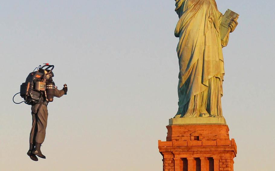 David Mayman, CEO and cofounder of JetPack Aviation, flies the JB-9 jetpack near the Statue of Liberty during a demonstration in November 2015. The company is now working on a prototype for U.S. Special Operations Command.