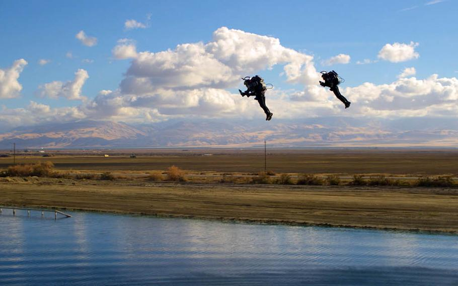 Jetpack Aviation CEO David Mayman and Boris Jarry, the company's operations director, fly over a lake near Taft, Calif., in December 2018.