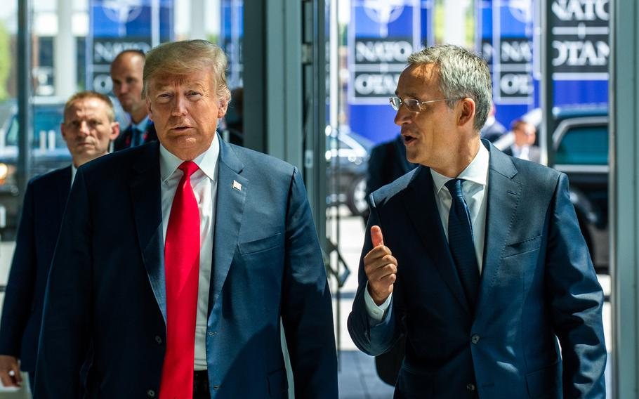 President Donald Trump walks with NATO Secretary-General Jens Stoltenberg at the opening of the NATO summit at the organization's headquarters in Brussels in July 2018.