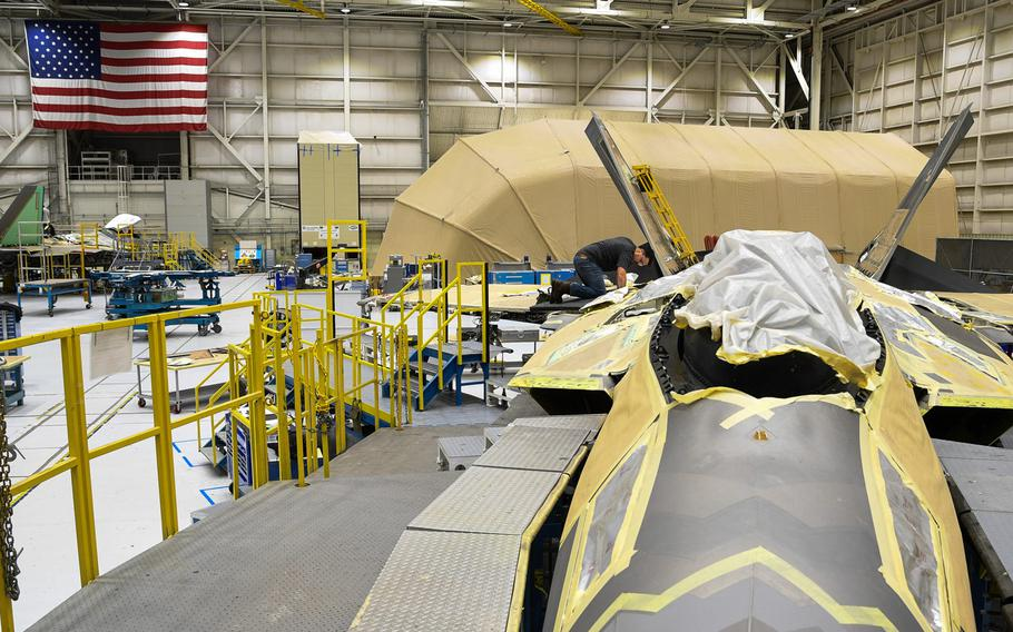A 574th Aircraft Maintenance Sqaudron maintainer performs depot maintenance on an F-22 fighter jet at Hill Air Force Base, Utah, Jan. 16, 2018. The 574th installed the first metallic 3D printed part on an operational F-22 in December.