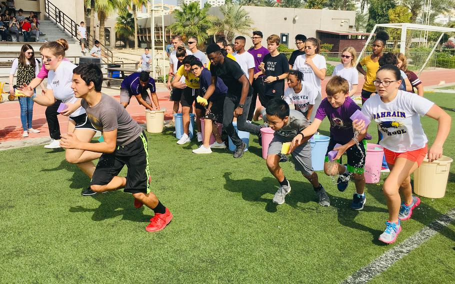 Students partake in a relay race during a field day event at Bahrain School on Jan. 17, 2019.