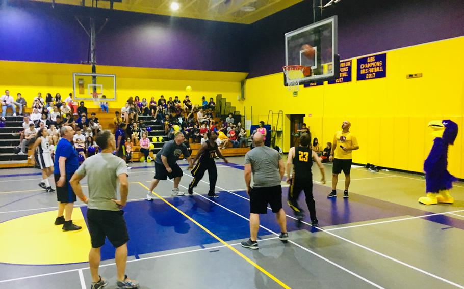 Faculty and student athletes play a friendly basketball game during a pep rally event at Bahrain School on Jan. 17, 2019.
