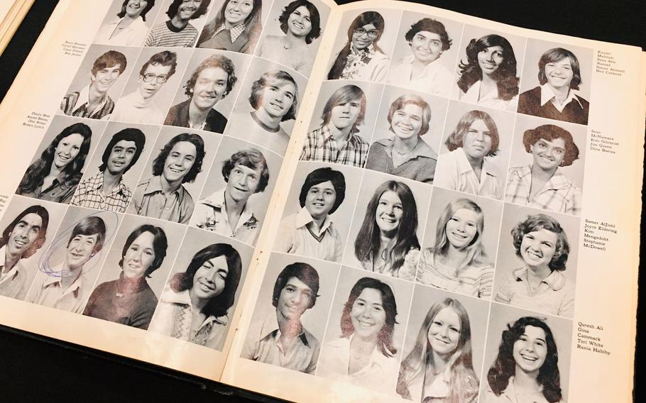 Archived yearbooks are on display at an alumni event at  Bahrain School on Jan. 17, 2019. The school is celebrating 50 years this week with events, alumni and basketball games.