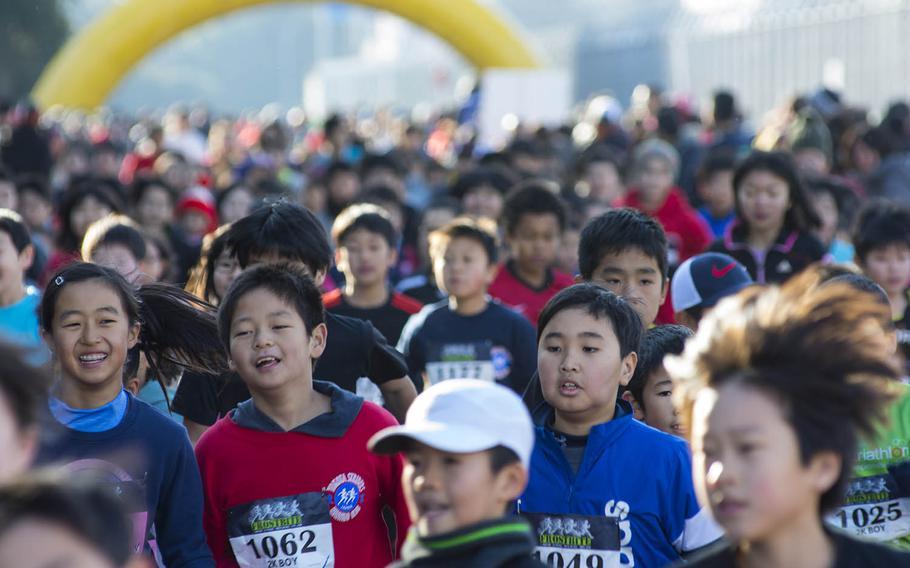 Children compete in the 38th annual Yokota Striders Frostbite Road Race at Yokota Air Base, Japan, Sunday, Jan. 20, 2019.