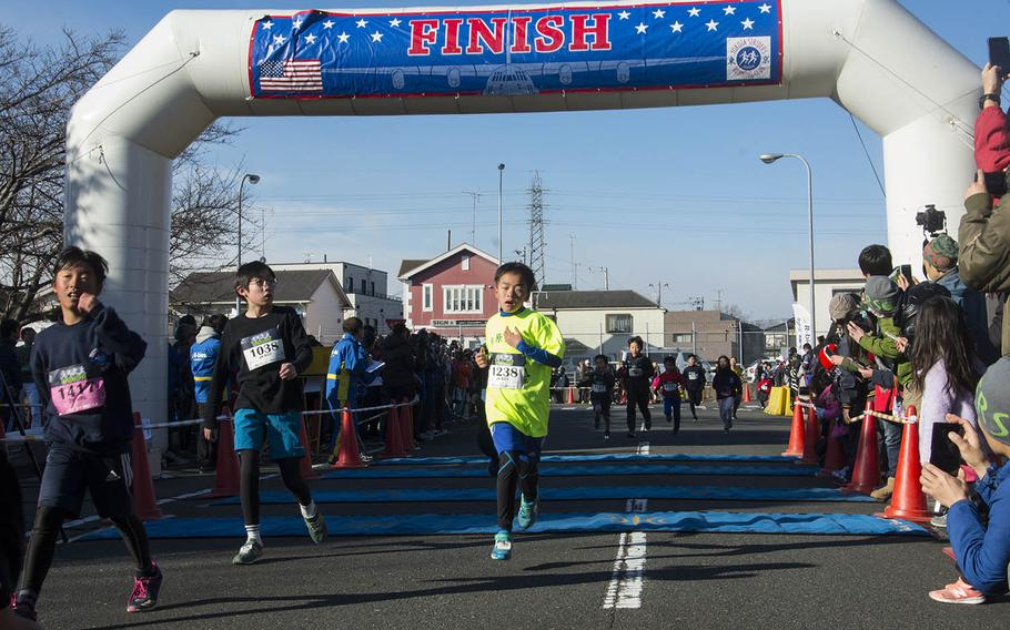 Young runners cross the finish line during the 38th annual Yokota Striders Frostbite Road Race at Yokota Air Base, Japan, Sunday, Jan. 20, 2019.