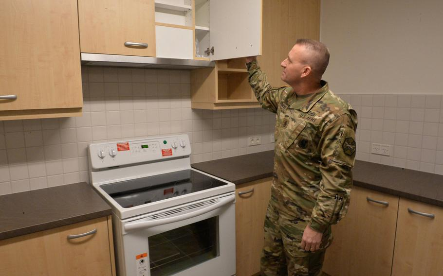 U.S. Army Garrison Rheinland-Pfalz Command Sgt. Maj. D. Brett Waterhouse inspects the kitchen of a newly constructed base housing unit in the Smith housing area of Baumholder garrison. Thirty two families have moved into the units, the first completed in a multi-year base development plan.