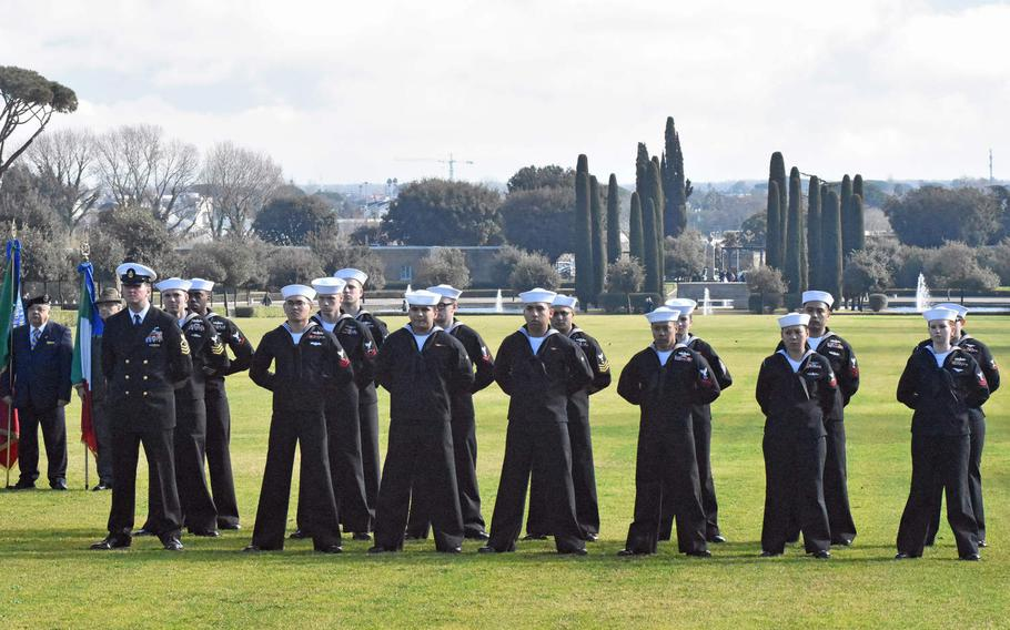 A contingent of U.S. sailors stand at parade rest at the Sicily-Rome American Cemetery on Jan. 22, 2019, during a ceremony paying tribute to the 75th anniversary of the Allied landings at Anzio and Nettuno.