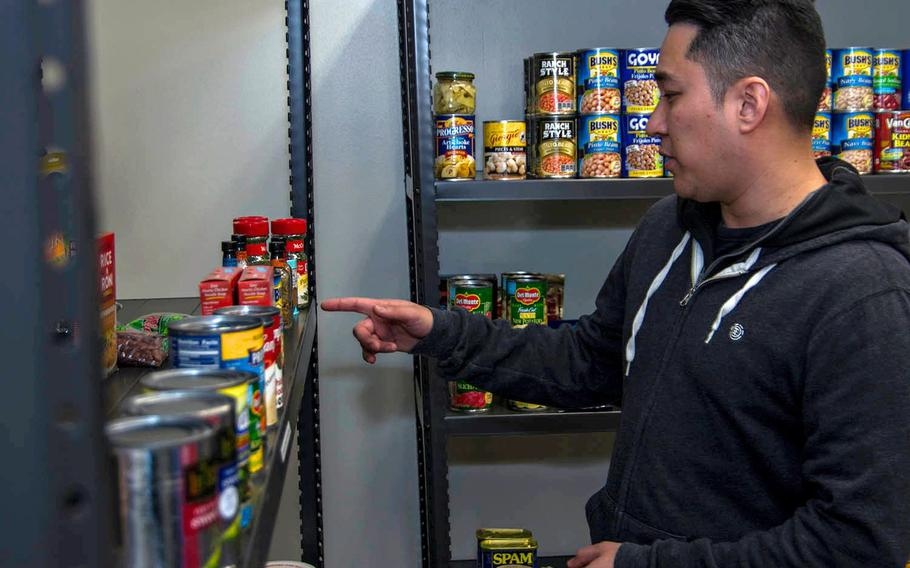 Information Systems Technician 1 Joseph Bruce takes donated items from the food pantry at Yokota Air Base, Japan, Thursday, Jan. 24, 2019.