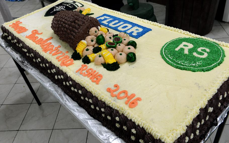 A Thanksgiving cake at Resolute Support headquarters in Kabul, Afghanistan in 2016 features the Fluor logo. The U.S. engineering and construction company is being sued for overcharging the government hundreds of millions of dollars for work in Afghanistan.