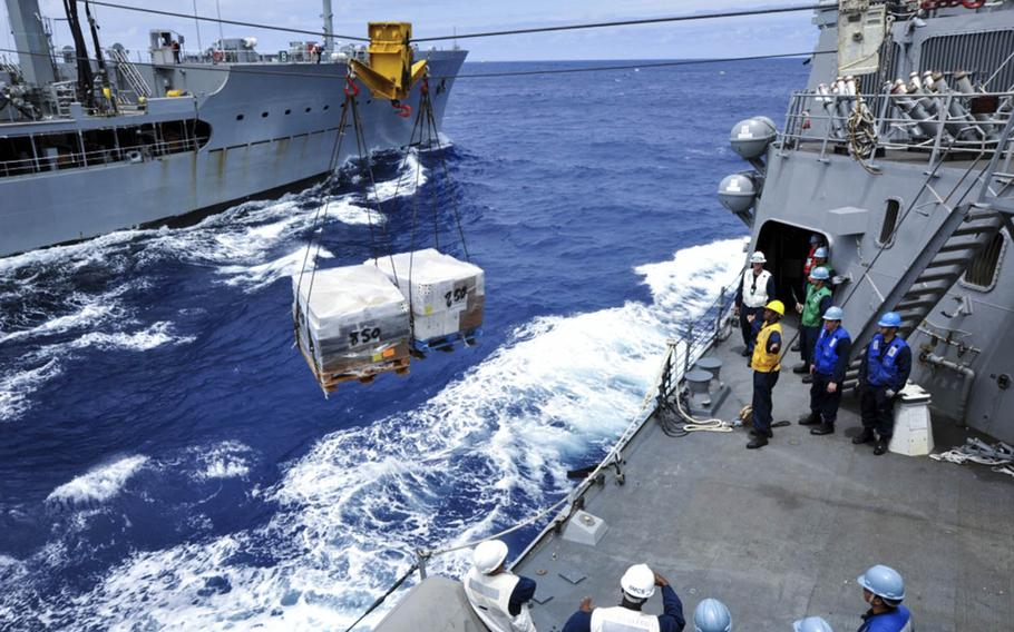 The USS McCampbell conducts a replenishment-at-sea with the fleet replenishment oiler USNS Walter S. Diehl on May 26, 2012.