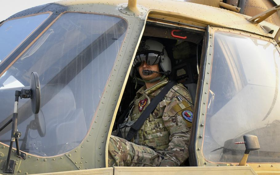 Afghan pilot Maj. Abdul Rahman Rahmani inspects his Russian-made helicopter between missions Dec. 12, 2018, in Kabul, Afghanistan.