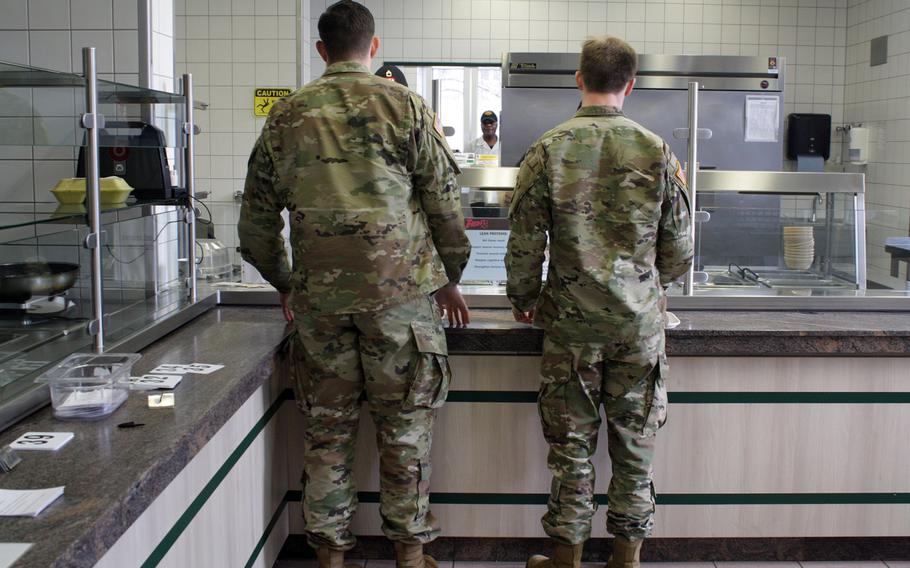 Troops with the 10th Special Forces Group get a meal at their dining facility at Panzer Kaserne, which began offering free meals Friday to members of the Stuttgart military community not getting paid because of the government shutdown.