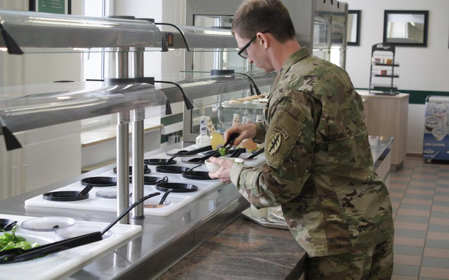 A soldier with the 10th Special Forces Group gets a meal at the unit's dining facility at Panzer Kaserne, which began offering free meals Friday, Jan. 25, 2019, to members of the Stuttgart military community not getting paid because of the government shutdown.