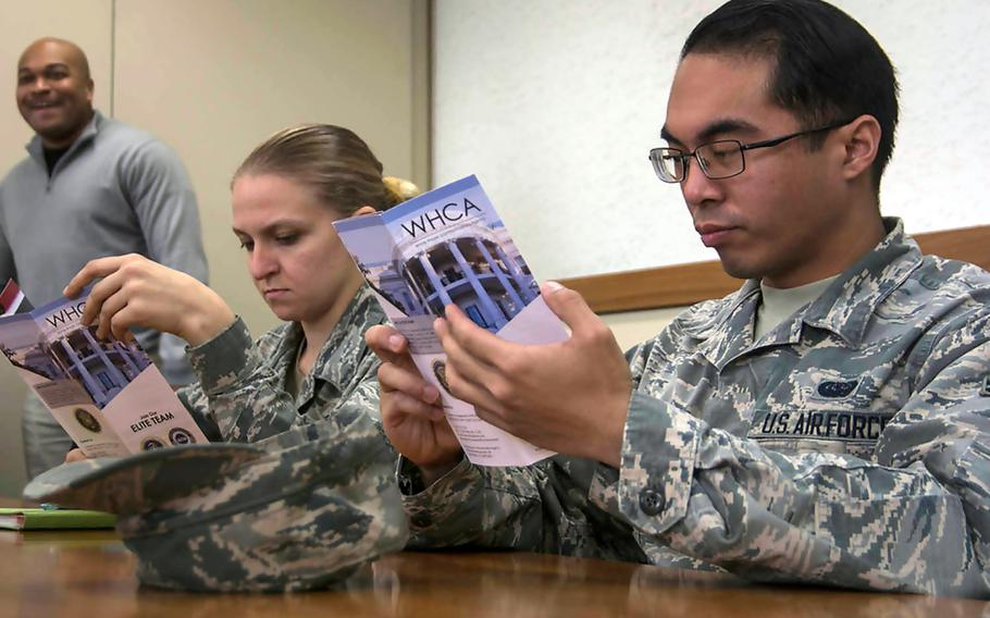 Servicemembers attend a recruiting seminar hosted by the White House Communications Agency at Yokota Air Base, Japan, Monday, Jan. 28, 2019.
