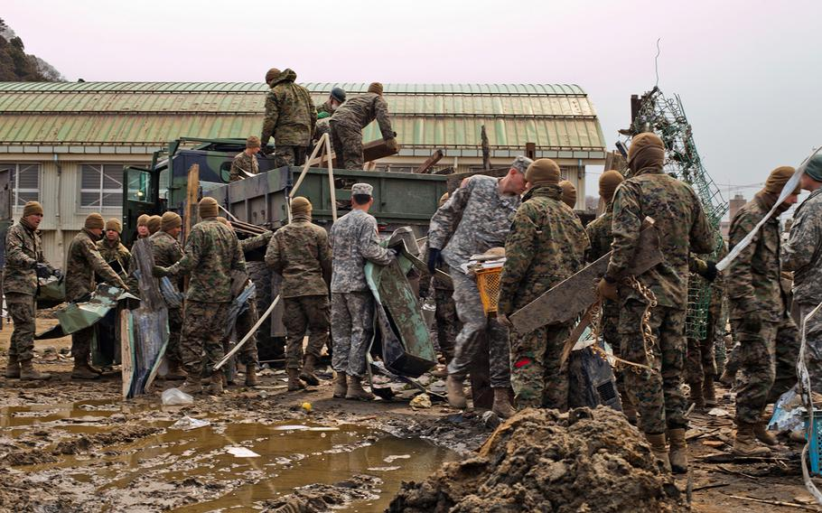 U.S. servicemembers help clean up an elementary school in Ishinomaki, Japan, April 2, 2011, after an earthquake and tsunami devastated northeastern Japan.
