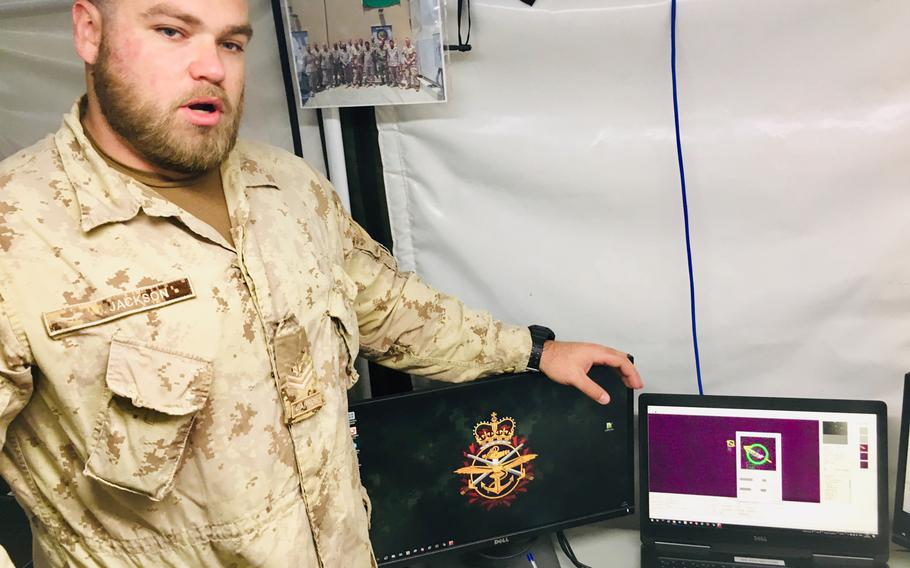 Combined Task Force CTF 150 member Master Cpl. David Jackson explains a satellite tracking system at Naval Support Activity Bahrain, Jan. 23, 2019.