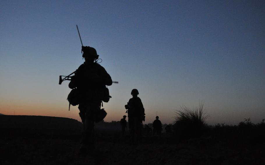 German soldiers finish a patrol at dusk in the Char Dara district, Kunduz province, Afghanistan. Two U.S. NATO allies in Afghanistan are questioning their future presence in the country following reports of a potential drawdown of American forces.