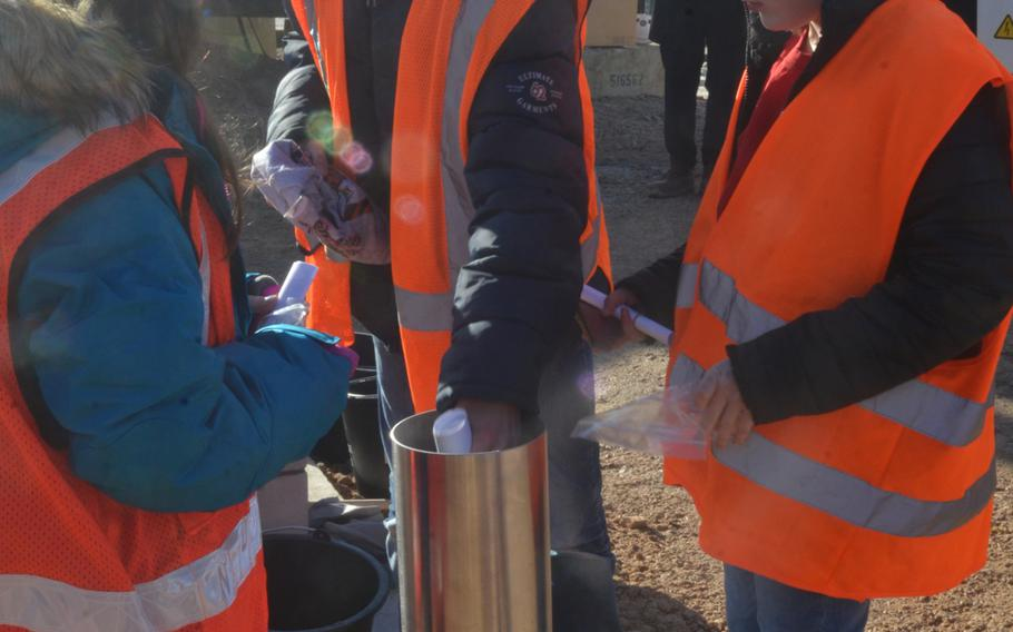 Students attending the current Wiesbaden Elementary School prepare a time capsule to be buried at the site of a new school in Wiesbaden, Germany, on Thursday, Feb. 14, 2019.
