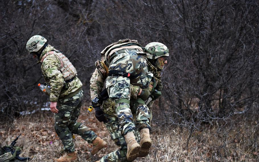 A Georgian soldier brings a mock casualty to safety during the Georgia Defense Readiness Program, Wednesday, Feb. 20, 2019.