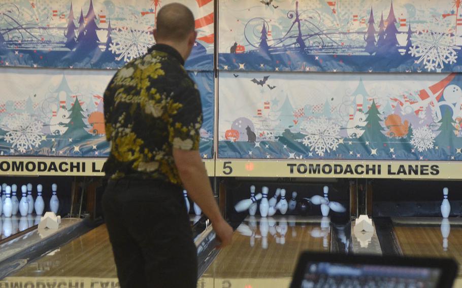 Brian Greenwood, a member of the Japan Professional Bowling Association, bowls a strike at the Yokota Air Base lanes on Feb. 6, 2019.