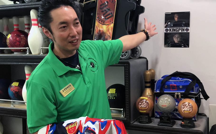 Takashi Kudoh, shown here Feb. 12, 2019, at Tomodachi Lanes at Yokota Air Base, Japan, runs a pro shop there that includes memorabilia such as a signed bowling poster with his photograph on it.