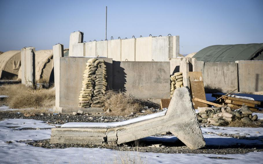 The remains of structures at what was once Forward Operating Base Shank in Logar province now fall apart due to a lack of resources to maintain them.