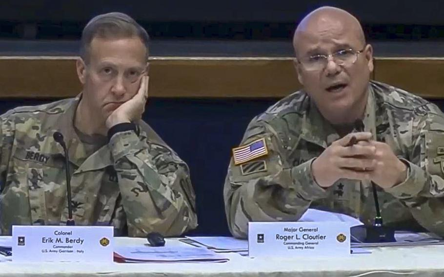 A video screen grab shows U.S. Army Garrison Italy Commander Col. Erik Berdy, left, and U.S. Army Africa Commander Maj. Gen. Roger Cloutier as they hear complaints from soldiers and civilians about the barracks, government-owned and leased quarters and private rentals during a town hall meeting about housing conditions at Vicenza on Friday.