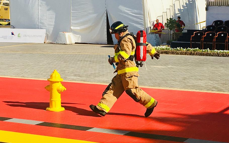 A firefighter with Naval Support Activity Bahrain Fire Department runs in the relay during the Bahrain Firefighter Challenge on Saturday, March 2, 2019.